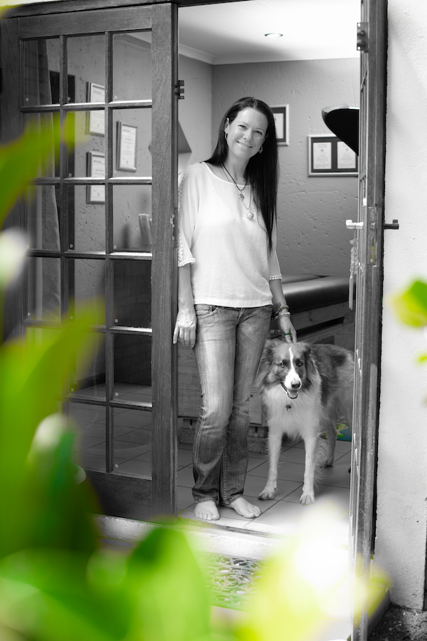 body stress release practitioner standing in door